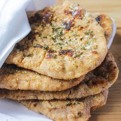 Whole Wheat Homemade Naan Bread: Enjoy the soft flaky crust and butter-y inside of homemade naan bread in a healthier version made with whole wheat flour! Homemade Naan Bread, Recipes With Naan Bread, Flour Recipes, Indian Food Recipes, Real Food Recipes, Cooking Recipes, Yummy Food, Indian Foods, Yummy Yummy