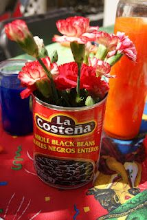 Centerpiece. Love to save money. Awesome Idea used it looks Wonderful. Mexican Centerpieces. Flower Vase! Mexican Party Ideas. Fiesta!