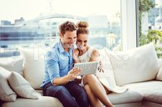 Couple using a digital tablet royalty-free stock photo