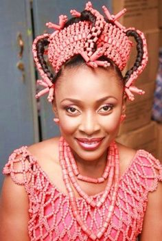Edo traditional bride of Nigeria with Okuku (beaded crown), and Ivie (coral beads- a symbol of royalty). Gorgeous!