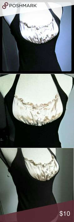 Bebe Black Halter Top/Cream Peekaboo Ruffles Sz S Bebe black halter top with cream colored peek-a-boo ruffles/buttons. In excellent pre-loved condition. Size L, fits more like M. Perfect for work paired with slacks or dress up with mini skirt/skinny jeans for girls night out or date night bebe Tops Blouses