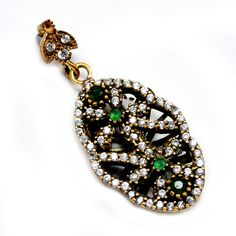 Silvesto India Emerald and Topaz (Lab) 925 Sterling Silver With Bronze Turkish Pendant PG-7029  https://www.amazon.com/dp/B01ESQP0XI