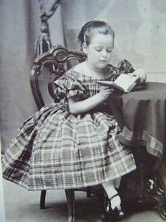 1860's girl in plaid dress