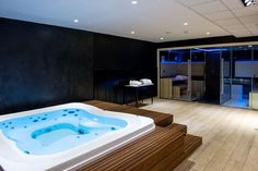 Wellness Center equipped with a recessed Enjoy spa and a combined Sauna / Shower .