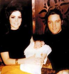 Elvis and Priscilla Presley at home with baby Lisa Marie, February, 1968.