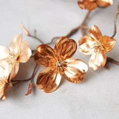 Add a metallic accent to wreaths, garlands, and faux bouquets with this branch of coppery dogwood flowers (ad) Susan Pevensie, Lucy Pevensie, Dogwood Flowers, Fabric Flowers, Joshua Brand, Seraphina Picquery, Dragon Age 2, Autumn Lights, Chronicles Of Narnia