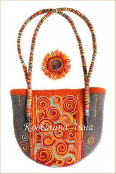 Viajar a Rusia por la web nos acerca a esta hermosa artista del fieltro Anna Kovylina . ¿ que puedo decir ?... sus carteras son hermosas!!!!...