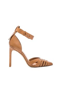 #REVOLVEclothing $160.00  Size Guide SIZE 6   6.5   7   7.5   8   8.5   9   9.5   10 Can't find your size? COLORCARAMEL  LIVE CHAT (IN RUSSIAN) ABOUT DOLCE VITA DESCRIPTION Leather upper with man made sole Heel measures approx 10 cm H Ankle notch closure Revolve Style No. DOLC-WZ558 Manufacturer Style No. KAIZA SIZE & FIT