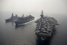 The aircraft carrier USS Theodore Roosevelt (CVN 71) participates in a replenishment-at-sea with the  Military Sealift Command fast combat support ship USNS Arctic (T-AOE 8) and the Britizh Royal Navy destroyer HMS Duncan (D 37).