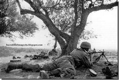 German paratroopers in action in Crete. That's an MG34.  1941