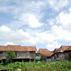 Traditional homes of Palembang. The edge of the roof resembles an animal horn.