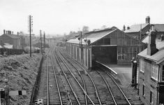 Bishop Auckland Railway Station.   This line was the freight line to Stanhope.  The park was on the right, where the swings and bandstand were.  We would stand on the bridge in the distance and watch the trains go by.