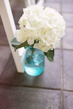 hydrangea in blue mason jar