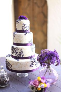 Love this purple cake.  Ours is more traditional- white and silver- but this is gorgeous too!