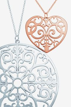 Let's hang out together this Valentine's Day. Tiffany Enchant® round pendant in sterling silver and heart pendant in RUBEDO® metal.