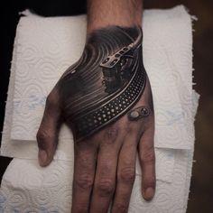 Vinyl Deck Hand Tattoo - http://giantfreakintattoo.com/vinyl-deck-hand-tattoo/