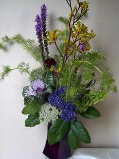 kinder moments bouquet with liatris, queen anne lace, dianthus, flowering kale, kangaroo paw, statice, bells of ireland