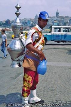 A Turkish street vendor sells çay (tea) from a large samovar in Istanbul   - Explore the World with Travel Nerd Nici, one Country at a Time. http://TravelNerdNici.com