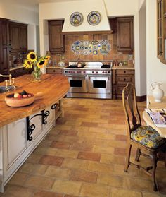 Kitchen with Wood Cabinets and Old Terra Cotta Floors.