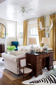 The desk behind the couch - great idea for antique desk!