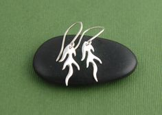 Tiny sterling silver flame charm earrings by jersey608jewelry, $22.00
