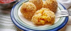 Easily turn a box of ho-hum into hallelujah by turning it into yummy, cheesy, crispy oven-fried mac and cheese balls. Perfect for parties and kids love 'em!