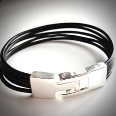 Silver Belted Leather bracelet. $22 from JewelryByMaeBee on Etsy.