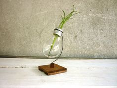 Recycled light bulb vase wooden stand upcycled holder for flowers from metal and wood and lightbulb