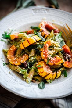 Whole Wheat Pasta with Walnut-Sage Pesto and Roasted Delicata Squash. A delicious, healthy, and EASY fall vegetarian pasta recipe!
