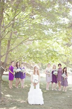 mismatched purple bridesmaid dresses. I have always loved the idea of saying these are the colors-go find a dress you truly like, and will wear again.  (With approval rights, of course.)