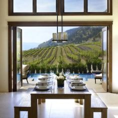 gorgeous house, neat modern table, infinity pool, private vineyard... the good life