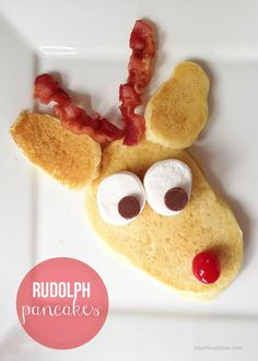 "To ""Rudolphize"" the pancake you'll need bacon, a cherry, chocolate chips, and marshmallows. Find the recipe here."
