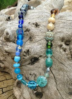 Mixed Glass Variegated Necklace with Blue Center by TripIntoLight, $12.00