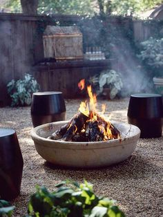 Love how the fire pit is a large stone bowl. Much simpler than stacking bricks!