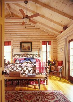 log cabin bedroom: The master bedroom accommodates a king size bed with plenty of room to spare.