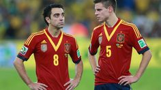 RIO DE JANEIRO, BRAZIL - JUNE 30: Xavi and Cesar Azpilicueta of Spain look dejected after being defeated in the FIFA Confederations Cup Brazil 2013 Final match between Brazil and Spain at Maracana on June 30, 2013 in Rio de Janeiro, Brazil. (Photo by Scott Heavey/Getty Images)