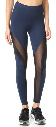frame leggings by KORAL ACTIVEWEAR. Mesh insets reveal a veiled peek of skin on these colorblocked KORAL ACTIVEWEAR leggings. Covered elastic waist. Fabr...