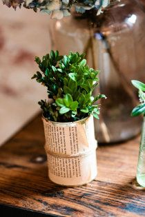 Very cute, and simple DIY centerpiece element!!, newspaper wrapped can...or maybe solo cup?