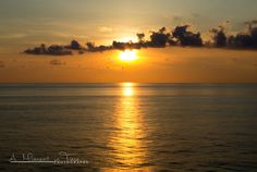 A beautiful view of a golden sunset on the ocean taken from a cruise ship. Available in full vibrant color. Available in either landscape or
