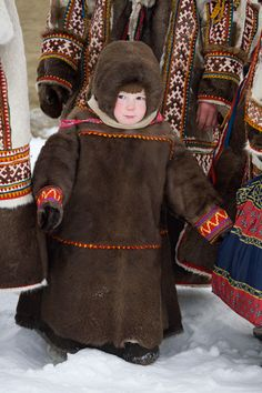 Nadia Tayshen, a young Khanty girl in traditional dress at a Spring festival in the village of Pitlyar. Yamal, Russia