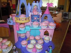 Use a toy to display cupcakes for a birthday party. This is the Little People Disney Princess castle.