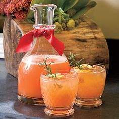 Rudolph's Tipsy Spritzer -- 5 cups orange juice, 2 cups Sprite, 1 1/2 cups vodka, 1/2 cup Grenadine, 1/4 cup fresh lemon juice.  Stir together all ingredients; serve over ice, garnish with lemon slices and fresh rosemary sprigs.