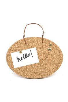 Keep your workspace or fridge organized with this compact cork board.