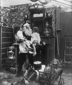 Santa Claus with children and toys 1900. Via Library Of Congress