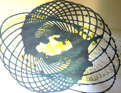 pendulum painting with kids - poke hole in the bottom of a plastic cup, string it to a stick, prop stick up between 2 chairs...fill the cup with paint and let 'er fly!