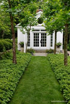 love this grassy verdant path with the charming white home as a backdrop. French doors | transoms <3