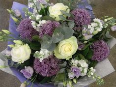 This delicate and pretty blue, lilac and white hand tied bouquet is the perfect choice for a baby boy. Chosen from a selection of seasonal flowers with beautiful foliage it is ready to place into a vase of water straight away.