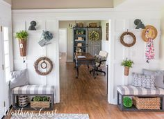 Fill a board and batten wall with baskets, grapevine wreaths and greenery to create a farmhouse feel    Worthing Court