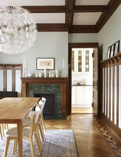 The dining room, where a table and light fixture from IKEA meet a collection of vases by Meissen and Rosenthal.