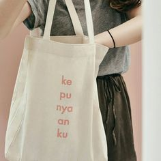 "248 Likes, 13 Comments - kukuku. (@shop.kukuku) on Instagram: ""I don't need a fancy bag. Give me a tote bag and i will wear it 24/7 ✌ Kepunyaanku totebag…"""
